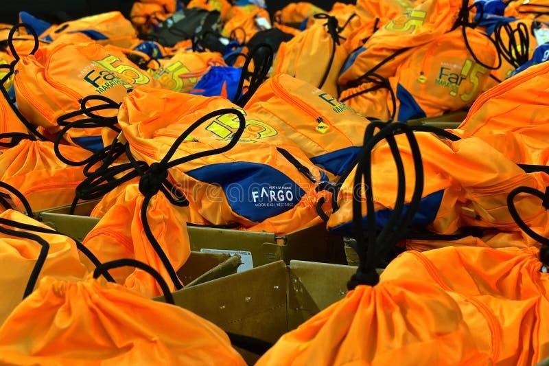 Fargo Marathoners back packs stored at the drop off station. FARGO, NORTH DAKOTA-May 136 2019 : Marathoners back packs are found at the drop off station at the stock photography