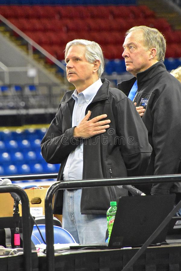 Senator John Hoeven at the Fargo Marathon. FARGO, NORTH DAKOTA-May 136 2019 : Senator John Hoeven pays respect to the USA during the National Anthem at the stock images