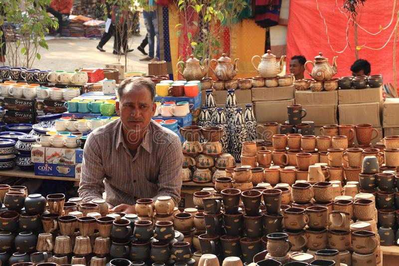 FARIDABAD, HARYANA / INDIA - FEBRUARY 16 2018: Crockery Seller a. T The Surajkund Crafts Mela - The largest Crafts Fair in the world with over 1 million visitors royalty free stock photo