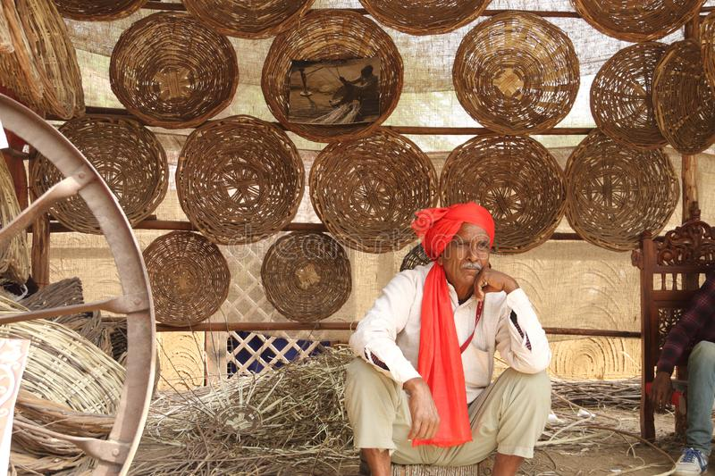FARIDABAD, HARYANA / INDIA - FEBRUARY 16 2018: Handmade Basket S. Eller at The Surajkund Crafts Mela - The largest Crafts Fair in the world with over 1 million stock photography