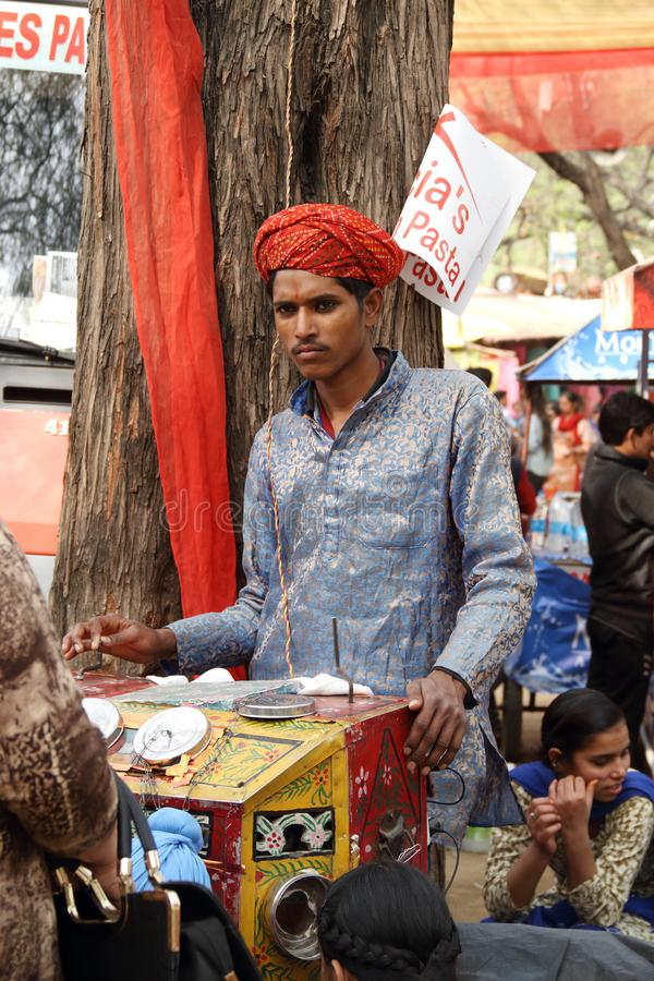 FARIDABAD, HARYANA / INDIA - FEBRUARY 16 2018: A villager showing Bioscope movie to kids at The Surajkund Crafts Mela - The large. St Crafts Fair in the world royalty free stock photography