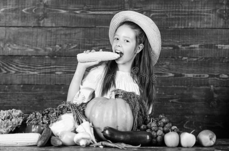 Farm activities for kids. Traditional farm market. Kid farmer with harvest wooden background. Child celebrate harvesting. Girl kid farm market with fall stock image