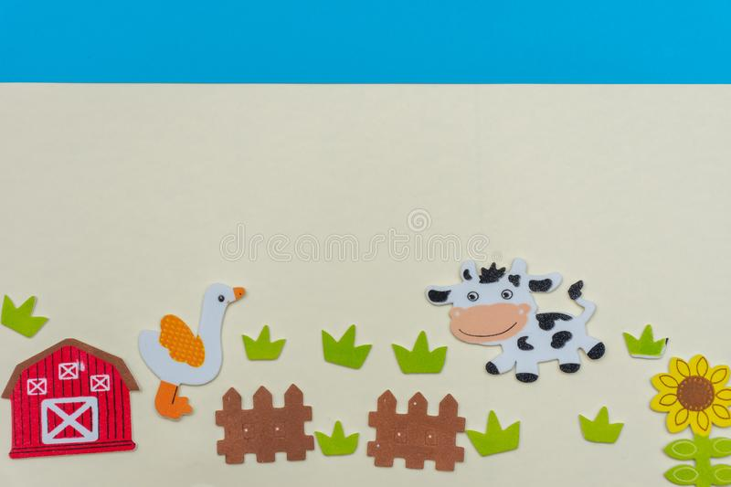 Farm animals on a flat lay with cows, grass, fence, blue sky, flowers and a farm house on a white background.  stock images