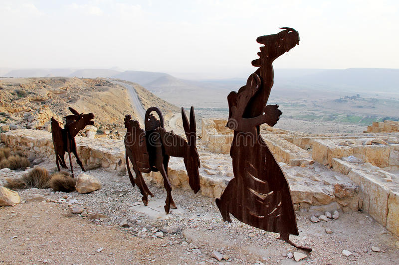 Farm animals and human statues in the Negev desert, En Avdat National Park,. Israel stock image