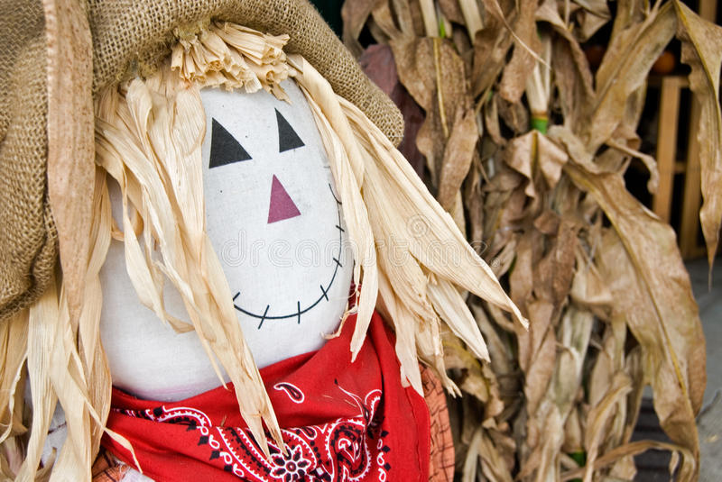 autumn in scarecrow in corn husks royalty free stock photography