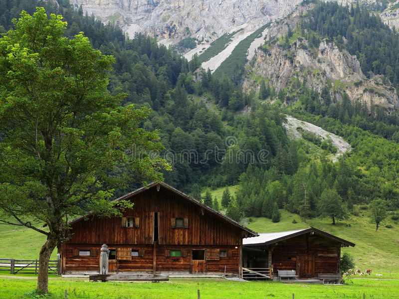 Farm building in alpine valley royalty free stock images