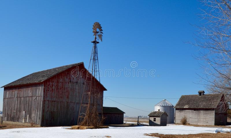 Farm Buildings, and a Weather Vane. This is a Winter picture of a small corn farm in Kendall County, Illinois. The pictures a weather vane, a barn, and weathered royalty free stock photography