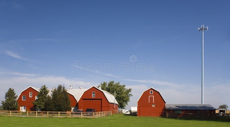 Farm with a cell tower. stock photography