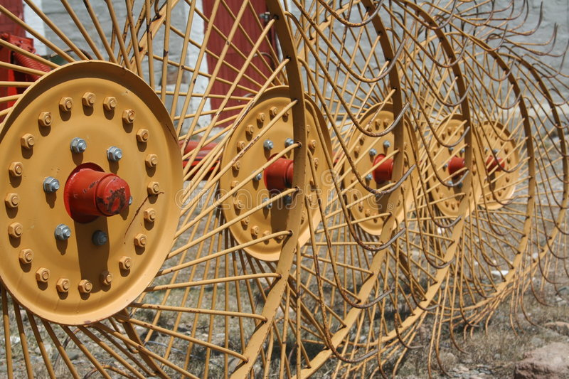 Farm equipment. With big yellow spikey wheels royalty free stock photo