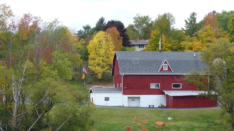 A Farm in Fall. A beautiful farm surrounded by brilliant Autumn colors royalty free stock images