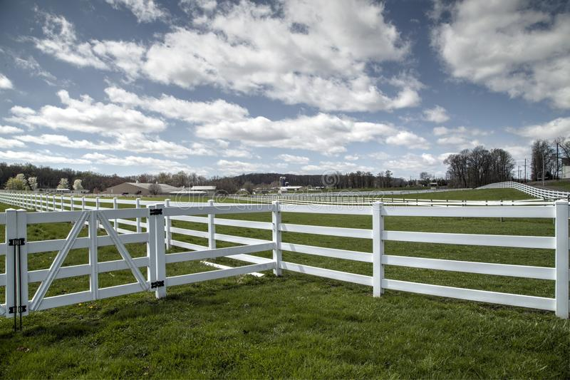 Farm fences. And blue sky with white clouds royalty free stock images