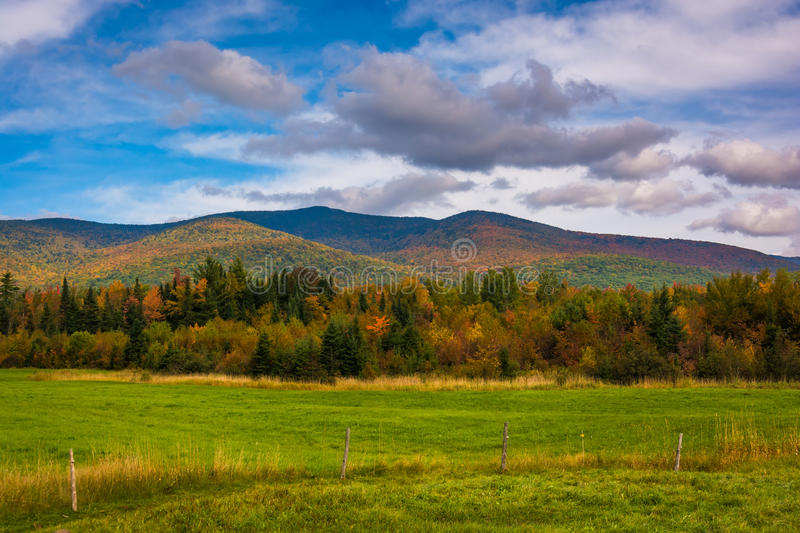 Farm field and autumn color in the White Mountains near Jefferson, New Hampshire. royalty free stock images