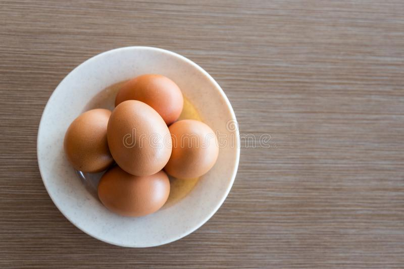 Farm fresh organic chicken eggs on plate with natural light stock photography