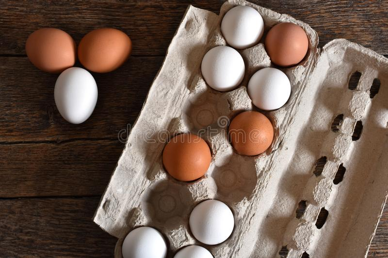 Farm Fresh Organic Eggs. A close up image of farm fresh organic eggs in a paper egg carton on a rustic wooden table royalty free stock photo