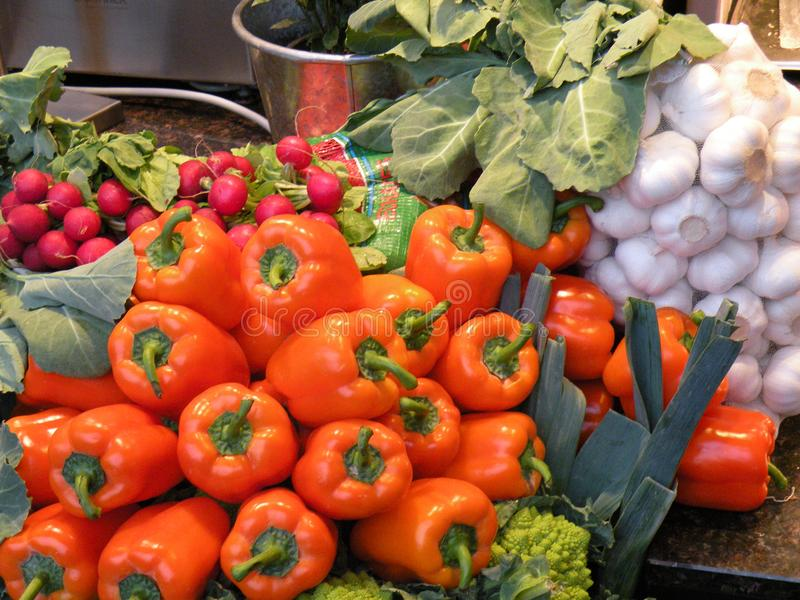 Vegetables For Sale - Red Peppers and Green Cauliflower royalty free stock photography