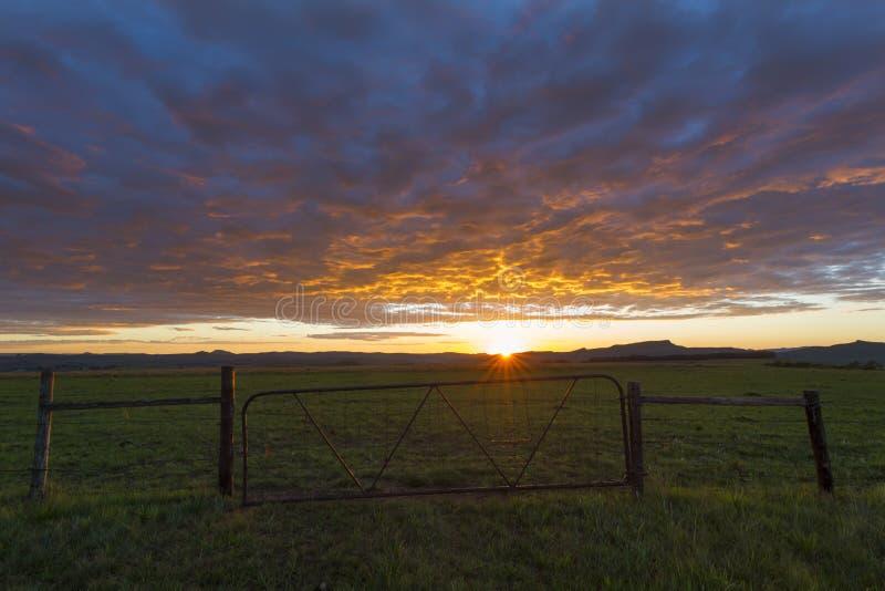 Farm gate at sunrise. Drakensberg South Africa stock photography