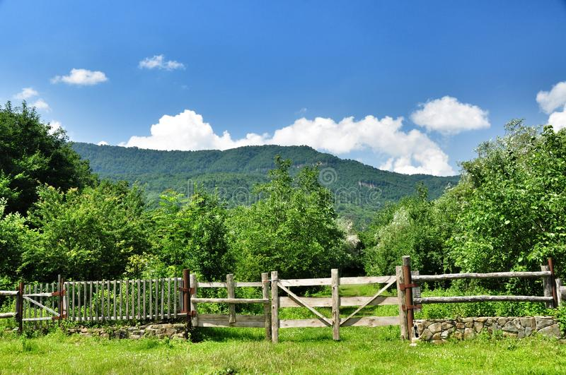 Farm gates. Old wooden gates garden fencing and pasture in an ecologically clean village in the Caucasus mountains. Krasnodar region. Russia royalty free stock image