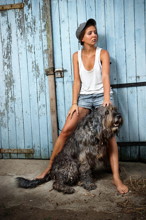 Download Farm girl with her dog. stock image. Image of outdoor - 13439913
