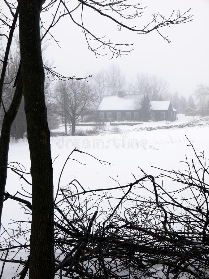 Farm: house in fog and snow stock photography