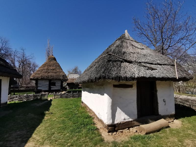 Farm house - inner yard. And straw roof. Old wooden peasant farm in the Maramures area, Romania stock photography