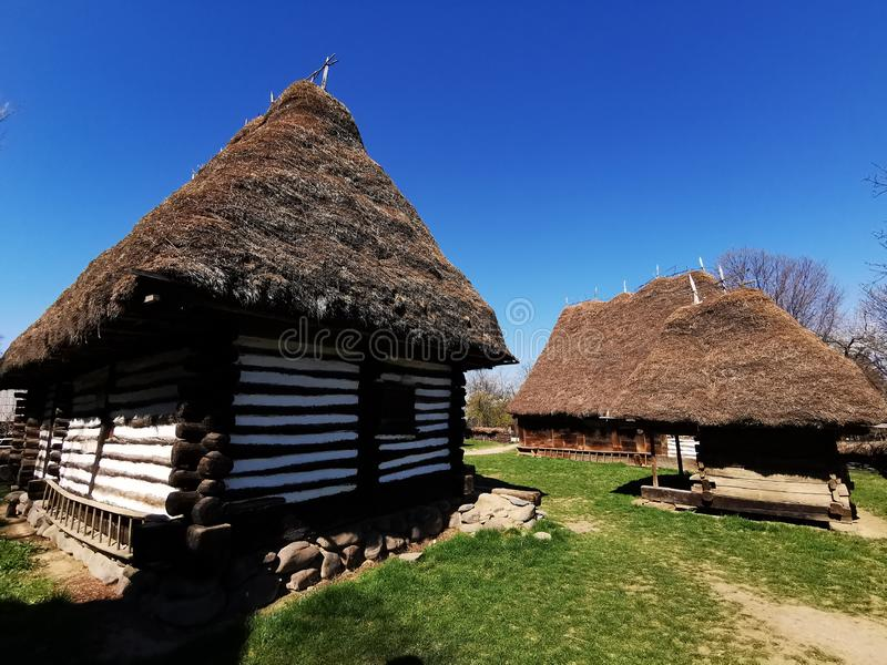 Farm house - inner yard. And straw roof. Old wooden peasant farm in the Maramures area, Romania royalty free stock images