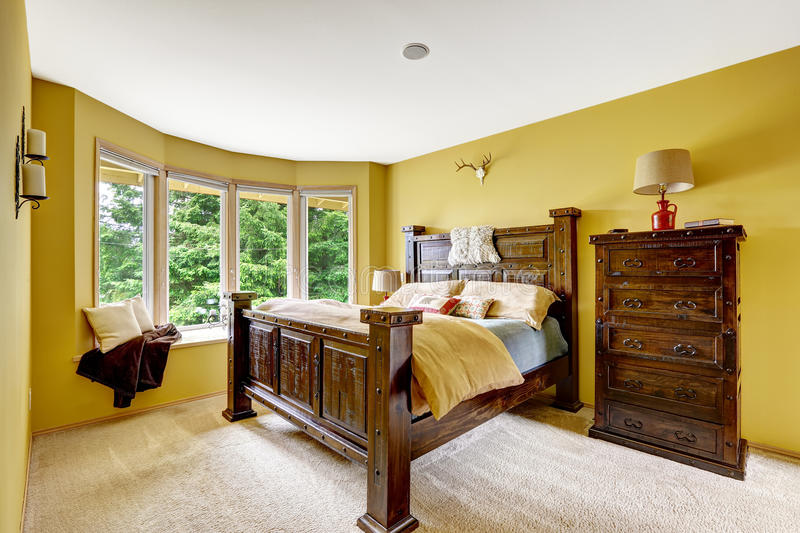 Farm house interior. Luxury bedroom interior with rich wooden furniture set stock image