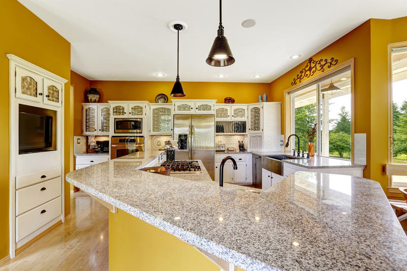 Farm house interior. Luxury kitchen room with big island and granite top royalty free stock photos