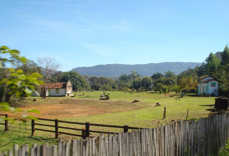 Small farm in Tiradentes, Minas Gerais, Brazil. The image shows a little farm in Tiradentes, Minas Gerais - Brazil. The image was taken from a train in moviment stock image
