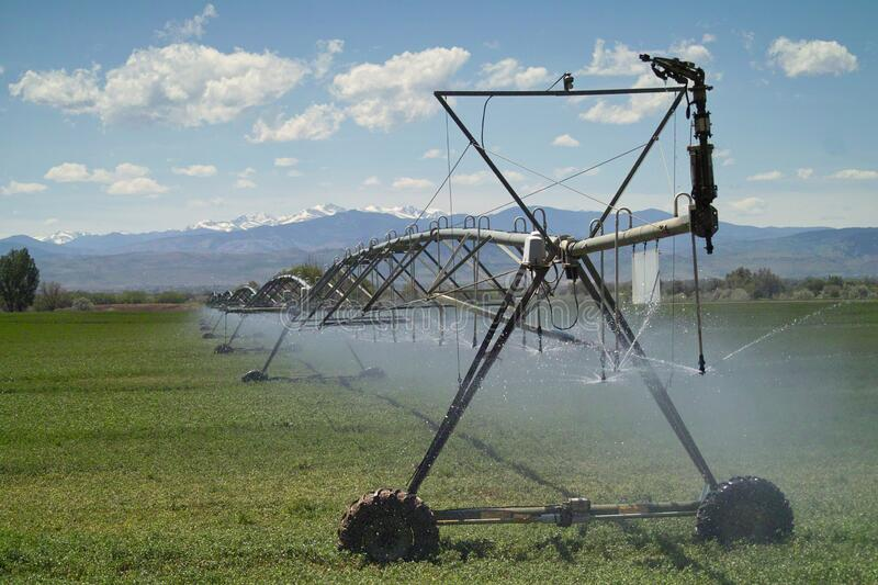 Farm irrigation Equipment watering a field royalty free stock photography
