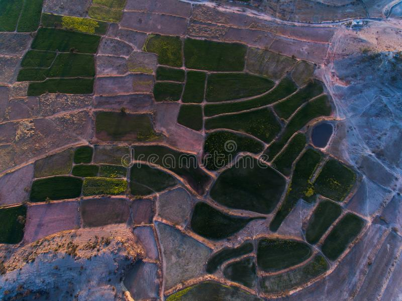 Ariel view of Farm lands and rocky area. Farm lands rocky area plateau pattern agri agriculture eco wheat crop mustard field farmer fields drone ariel view royalty free stock image