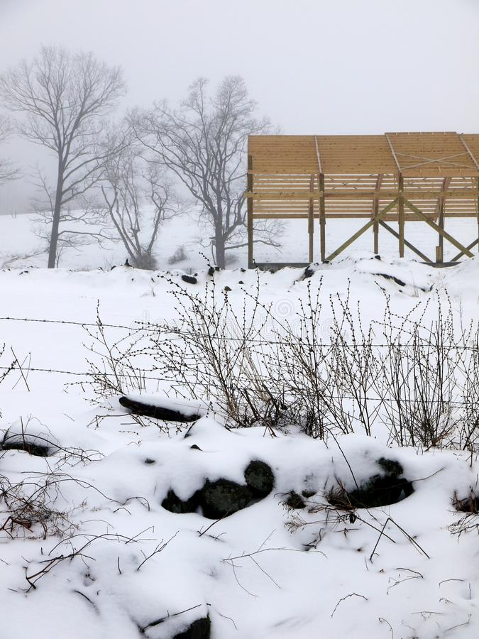 Farm: new barn construction winter fog royalty free stock photography