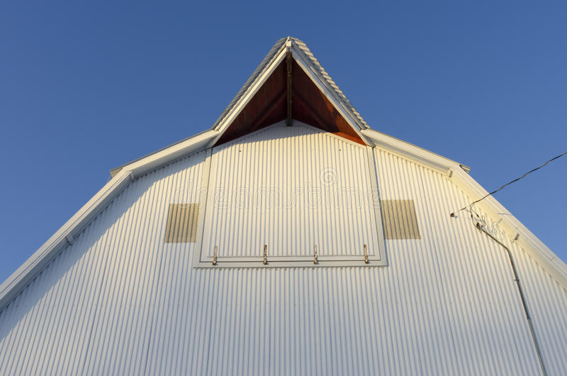 A farm in Northern Iowa and a metal barn. A metal/steel barn in Ottosen, Iowa stock photos
