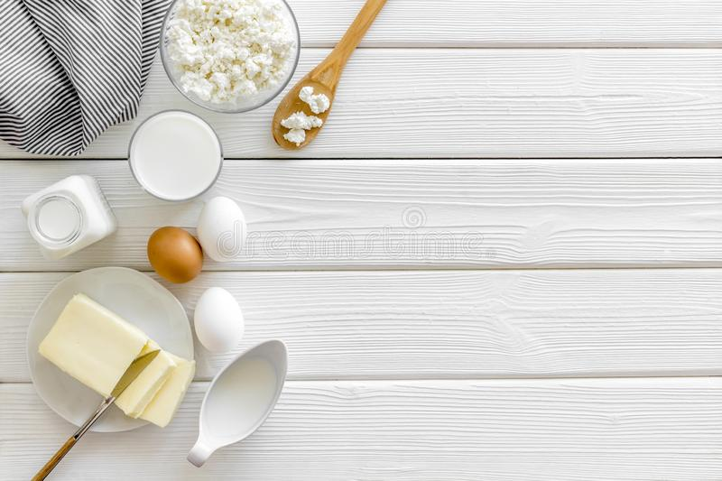 Fresh dairy products for breakfast with milk, cottage, eggs, butter, yougurt on white wooden background top view mock up stock photos