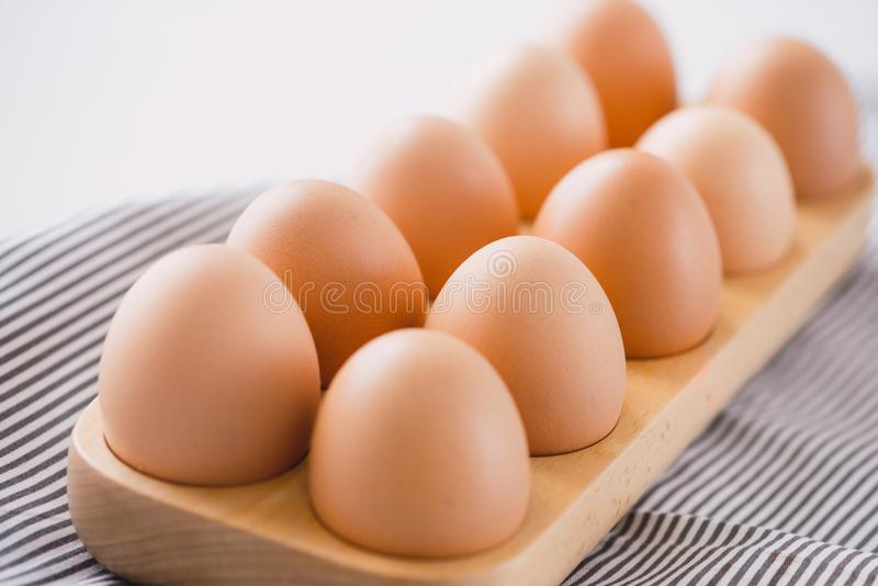 Farm raw fresh egg in pack on gray table ingredient for breakfast preparation scrambled eggs omelet fried egg royalty free stock image