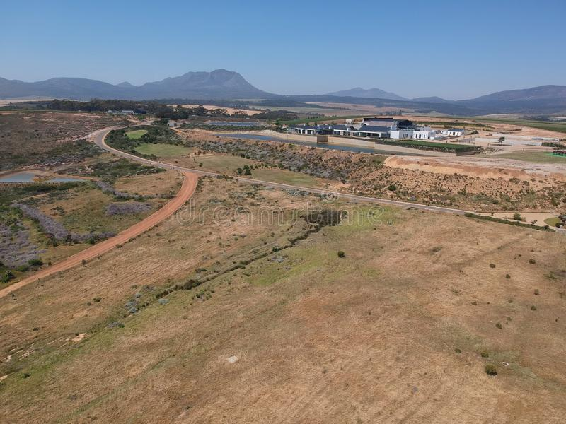 Farm roads with distant mountain views. Blue skies and distant mountain views, diverging farm roads and small dams stock image