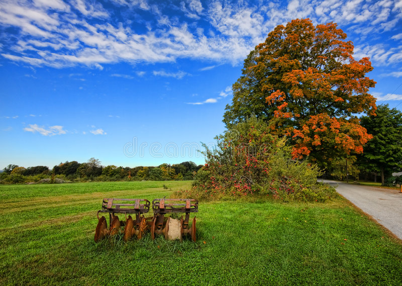 Farm Scene. Rural scene in early fall with vintage farm equipment royalty free stock photos