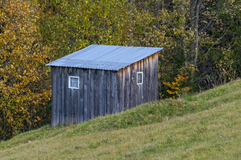 Farm shed on a forest edge stock image