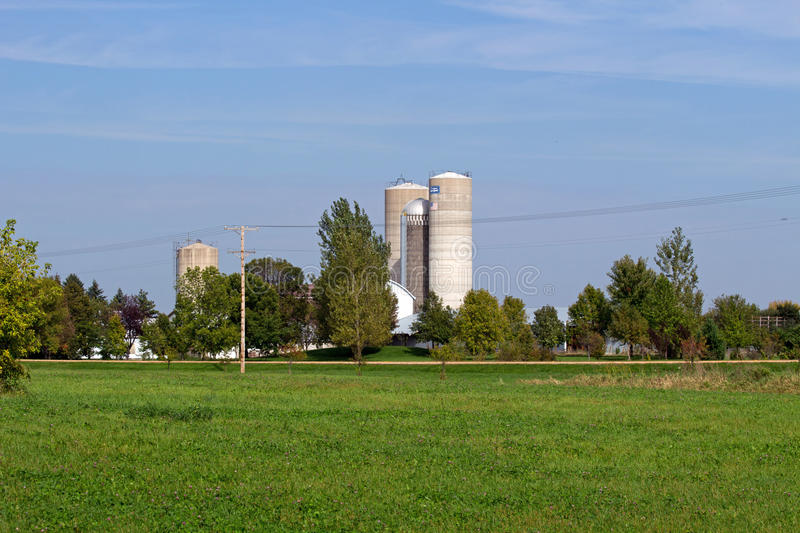 Farm Site with Tall Silos. Minnesota has numerous farm sites across the entire state. These silos are very large. The rest of the buildings are minimal compared stock photo