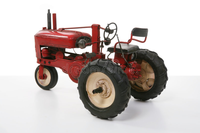 Farm Tractor. An old vintage tractor on a white background royalty free stock photography