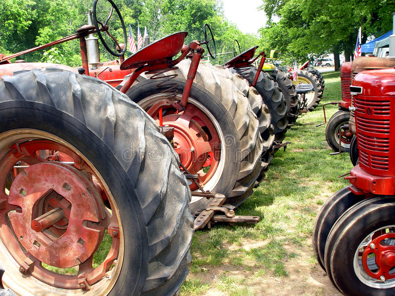 Farm Tractors. Antique farm tractors at a country fair royalty free stock photos