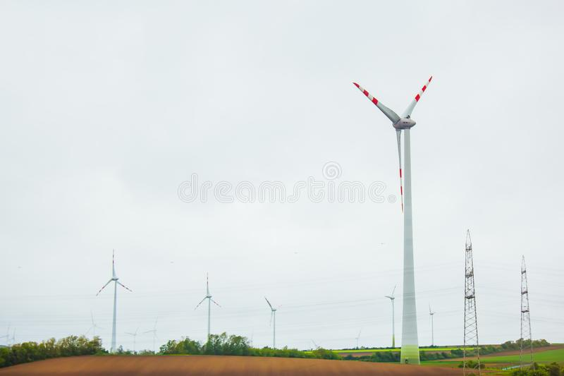 Farm of wind electricity generators. alternative power from renewable energy. environmentally friendly production. windmills stock photos