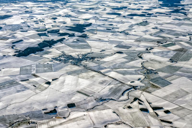 Farmed fields covered by snow aerial panorama royalty free stock image