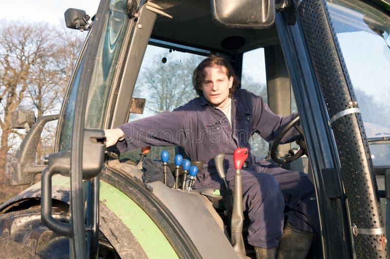 Farmer. Closing the door of a tractor stock photos