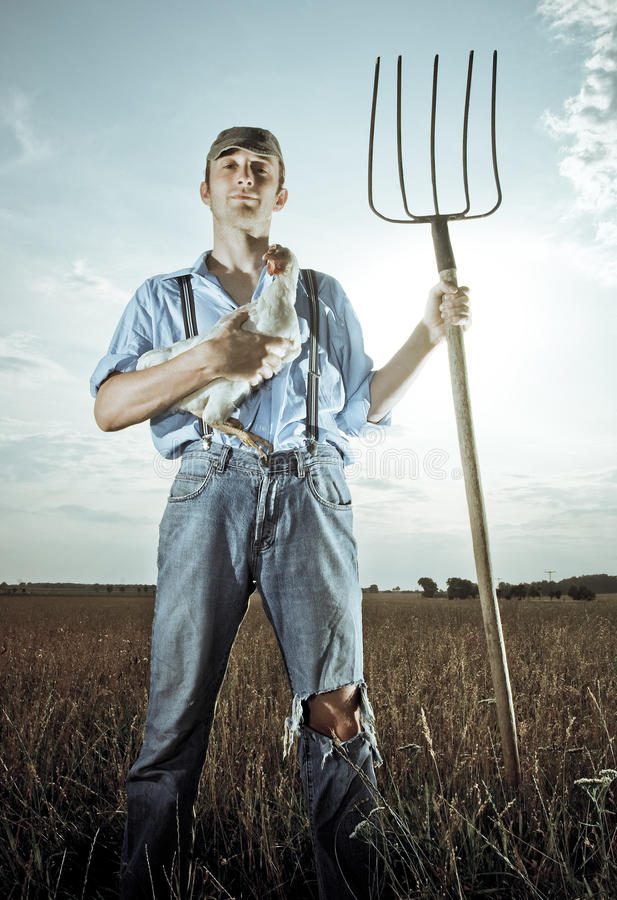 Farmer with Chicken royalty free stock photos