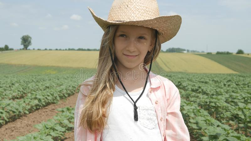 Farmer Child in Sunflower Field, Girl, Kid Studying, Walking in Agrarian Harvest royalty free stock images