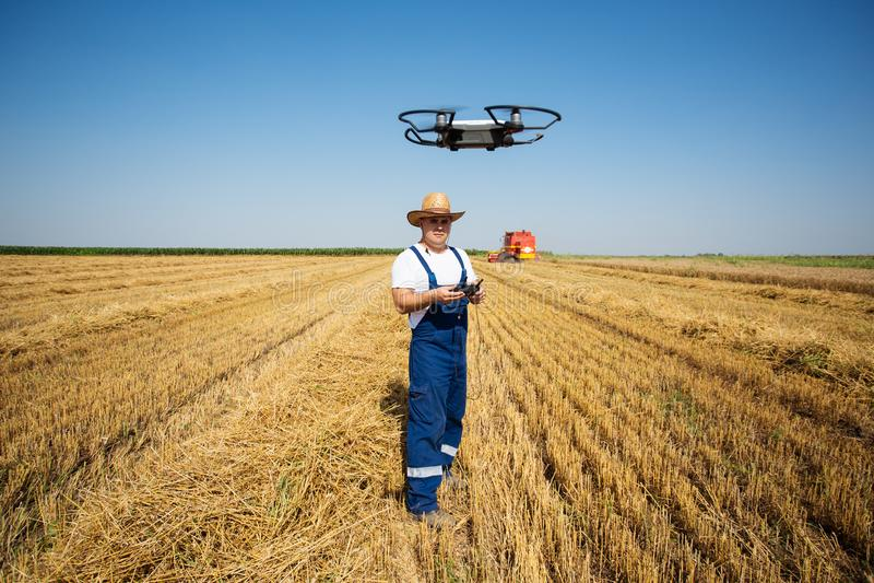 Farmer Control a drone on the wheat field. Young Farmer Control a new drone on the wheat field stock photo