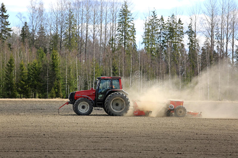 Farmer Cultivates Field at Spring royalty free stock photos