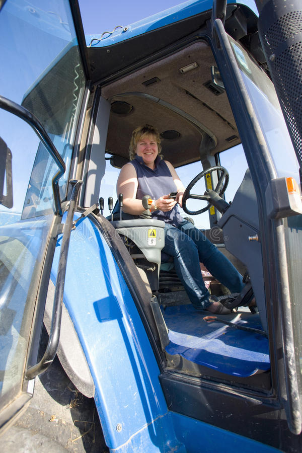 Farmer driving tractor stock images