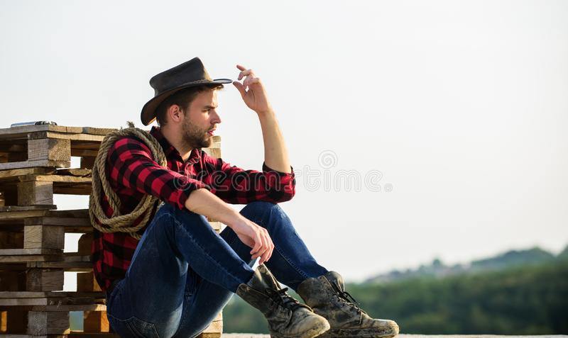 Farmer enjoy view from his farm. Peaceful mood. Watching sunset. Farmer cowboy handsome man relaxing after hard working stock photos