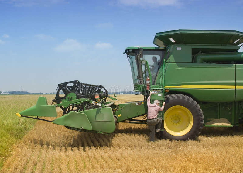 Farmer Exits Harvester stock photo